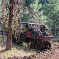 Using an ATV to get it done.