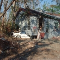 House crushing a car.